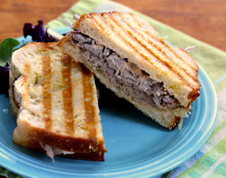 Roast beef panini with caramelized onions and horseradish sauce. It's a new classic.