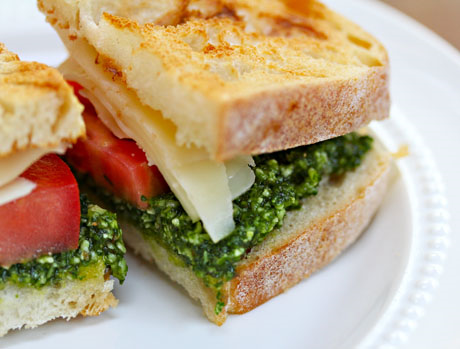 Don't have kale pesto? Use your favorite pesto on this tomato and fontina sandwich.