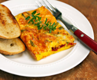 Egg-casserole-with-italian-cheeses-sun-dried-tomato-and-fresh-herbs