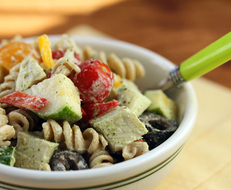 Pasta salad with chunks of turkey and vegetables, and a feta dressing.
