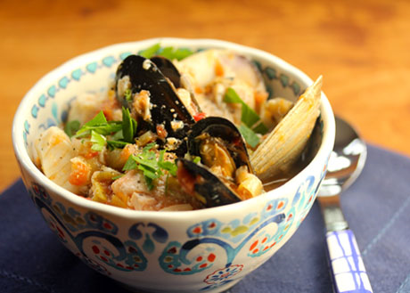 Seafood stew, packed with mussels, clams, scallops and fish.