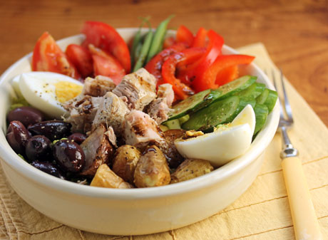 Salad with lots of Nicoise ingredients: beans, olives, potatoes.