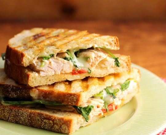Turkey, creamy brie, roasted red pepper, spicy arugula: piled into one great sandwich!
