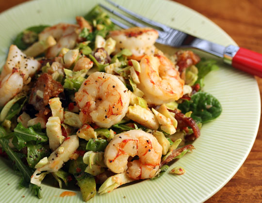 Brussels sprouts, bacon and greens, topped with roasted shrimp (optional), make a fabulous main course salad. #glutenfree