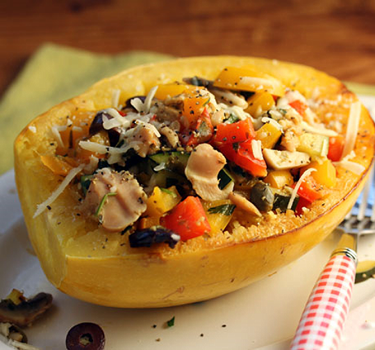Sweet, roasted spaghetti squash boats filled with clams, vegetables, olives and cheese. Kids love them! #glutenfree