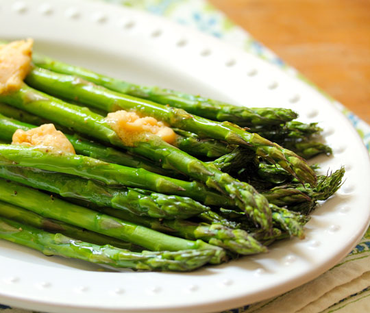 Roasted asparagus with ginger-miso butter, the perfect side dish for anything you toss on the grill. [ThePerfectPantry.com]