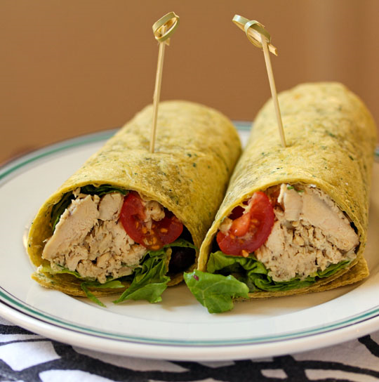 Shredded Greek chicken, made easy in the slow cooker, piles into tortilla wraps with tomato, olives and feta.