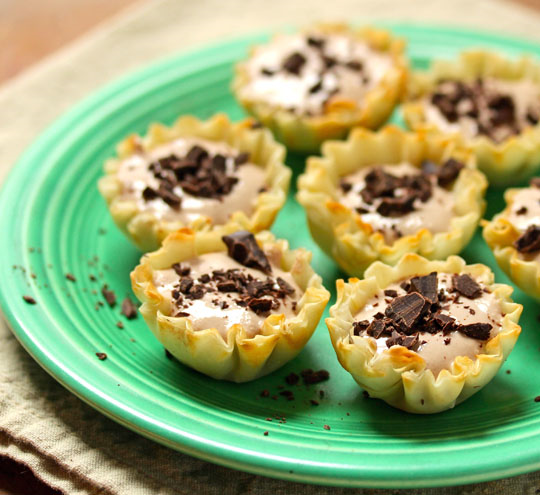 Sweet mocha ricotta cream phyllo shells, topped with bits of chocolate.