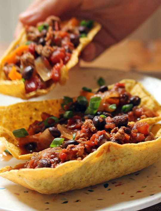 Three-chile taco boats filled with turkey and black bean sauce. Just add your favorite toppings! #glutenfree