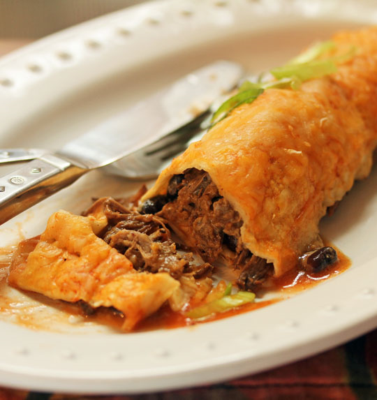 Chipotle beef enchiladas are quick and easy for weeknight dinner if you've made the slow cooker beef ahead of time.