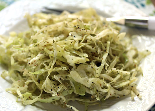 A simple side dish of cabbage wilted by a warm lemon-dill dressing will be great on the holiday table.
