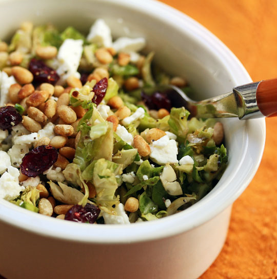 Shaved Brussels sprouts tossed with dried red cranberries, feta and pine nuts: perfect for the winter holiday table.