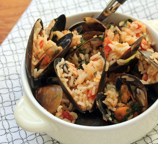 A big pot of mussels and rice that will make you feel like you're sitting on a beach at sunset! [ThePerfectPantry.com]