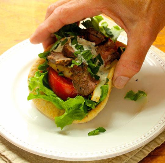 Grilled boneless leg of lamb seasoned with lemon, garlic, allspice and cinnamon: exotic!