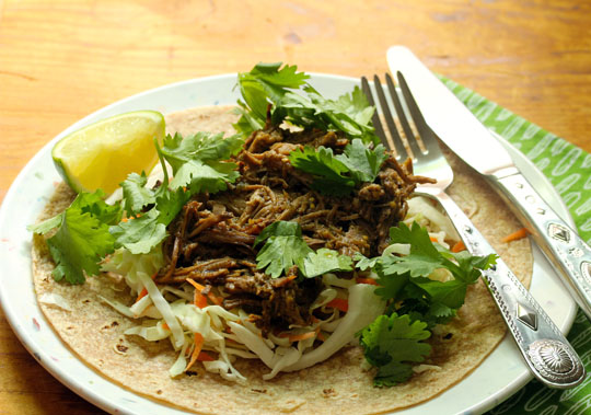Get your slow cooker on! This salsa verde shredded beef is perfect for tacos, quesadillas, or even in omelets!