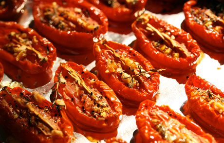 Make a batch or two of slow-roasted tomatoes, and freeze them to use all year long.