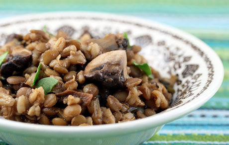 Barley and lentil pilaf, packed with mushrooms and spinach, is a hearty cool-weather #vegan main dish.