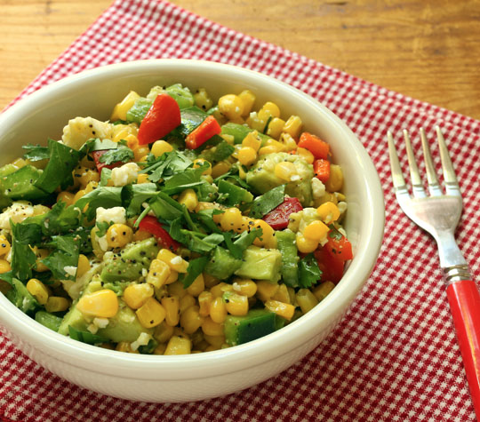 Roasted corn salad, good at any time of year. Use frozen corn and jazz it up in the oven. #glutenfree #vegetarian