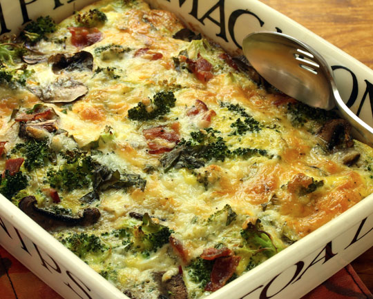An egg and two-cheese breakfast casserole, packed with lots of broccoli, mushrooms, bacon and herbs, can be a dinner entree or the centerpiece of a brunch buffet.