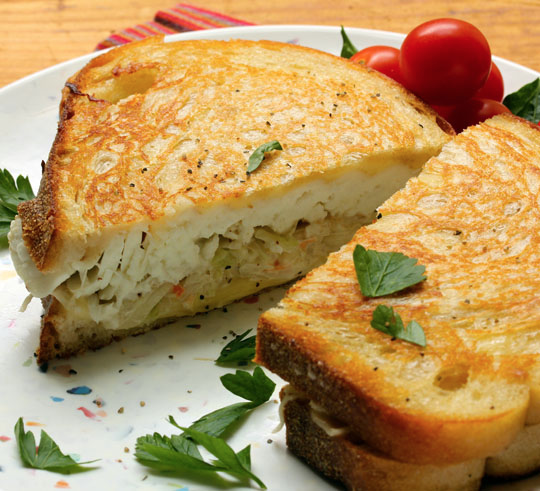 Fish, cabbage and Swiss grilled cheese sandwiches combine the best of two diner favorites into one great meal.