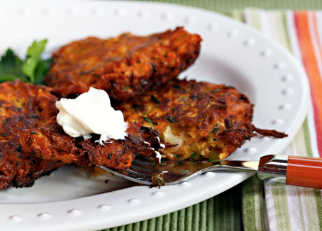 Sweet potato pancakes with sour cream, a vegetarian treat.