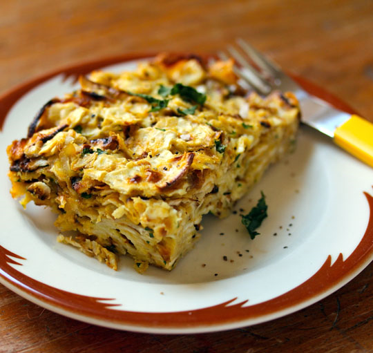 Oven-baked matzoh brei, for Passover or all year long. This one has caramelized onions for added sweetness. [ThePerfectPantry.com]