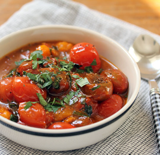 A bowl of burst tomatoes, for dipping or to use as a bright, fresh sauce for pasta.