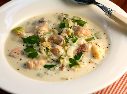 Atlantic Canada seafood chowder, packed with clams, lobster, and fresh herbs.