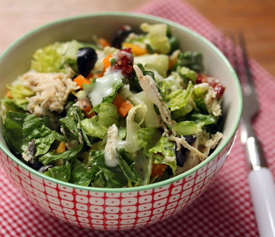 Add shredded Greek-flavored chicken to this crisp chopped salad for a meal-in-a-bowl.