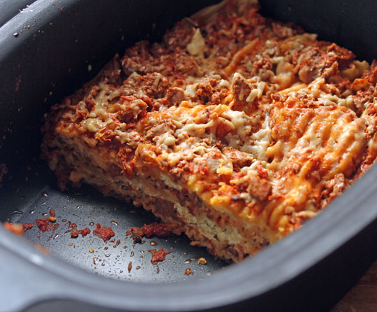 A pan of this slow cooker lasagna takes minutes to prepare, and cooks all afternoon while you're doing other things.