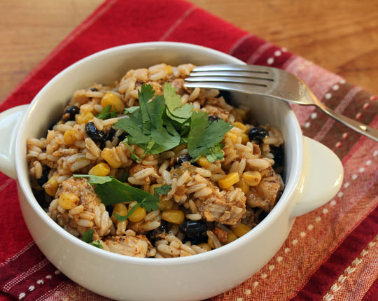 Slow cooker Tex-Mex chicken and rice, a one pot meal with corn and black beans cooked right in it.