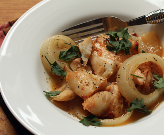 Braised Tunisian-style white fish, a lean and flavorful choice for a healthy menu. #glutenfree