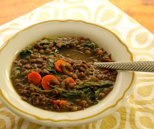 Season-spanning lentil and caramelized onion soup, with dark leafy greens. #vegan [ThePerfectPantry.com]