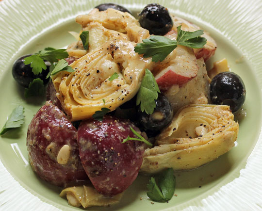 Add some chickpeas to this potato and artichoke salad, for a complete meatless meal. #vegan #glutenfree