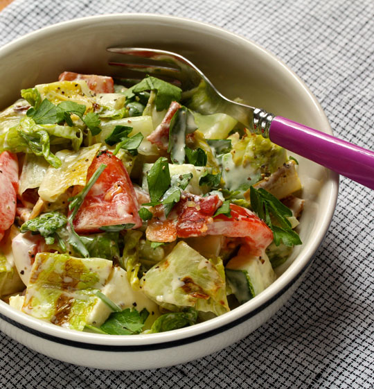 Grilled lettuce adds a whole new flavor to this leafy summer salad.