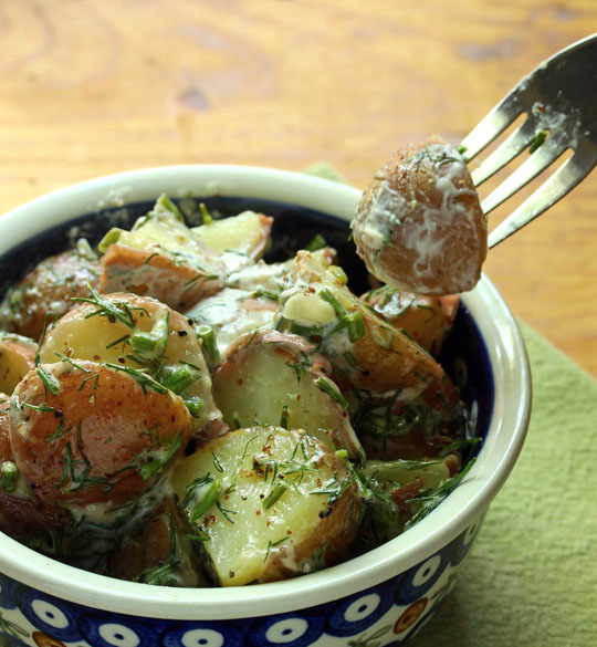 A good handful of fresh dill sends this easy potato salad over the top!