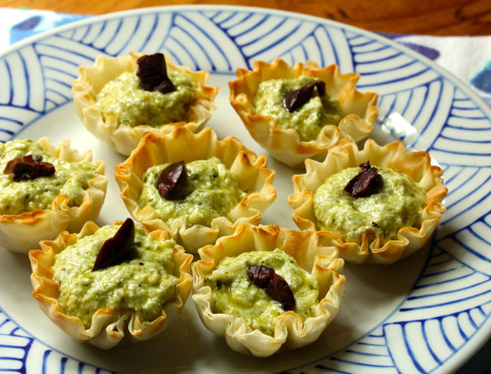 Ready-to-use mini phyllo shells are a convenience food you should always have in the freezer! Make easy appetizers like these no-bake pesto cheese phyllo bites.