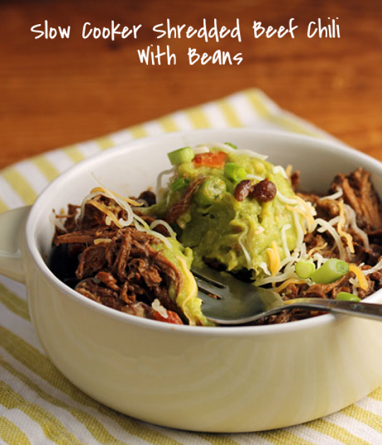 Slow cooker shredded beef chili with black beans, topped with guacamole and a hit of lime: so good!