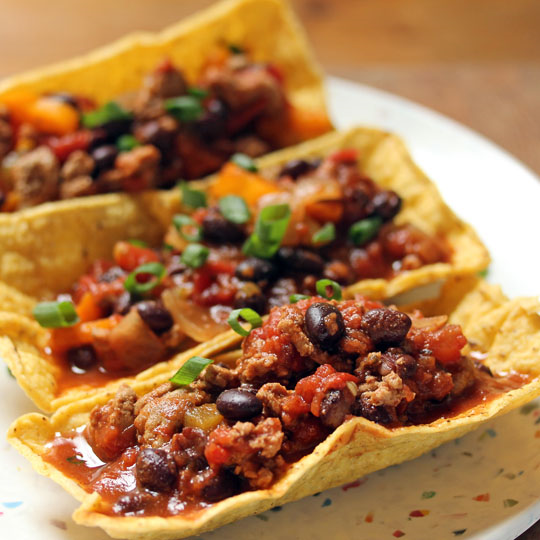 Our favorite turkey and black bean Tex-Mex sauce, jazzed up in gluten-free tacos.