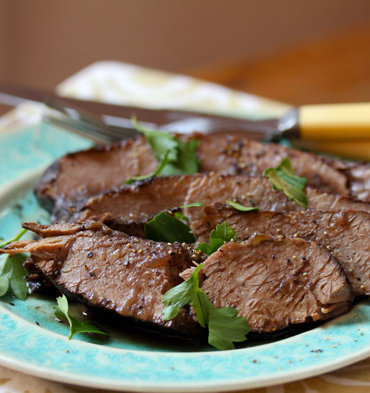 Grandma's beef brisket, braised in red wine until it practically falls apart!