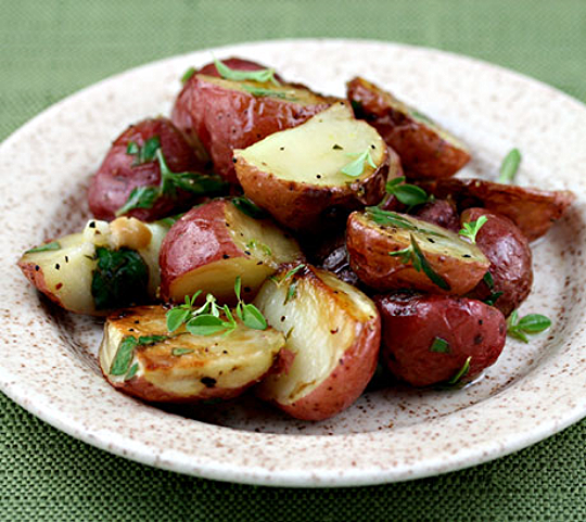 Roasted potatoes with lemon thyme vinaigrette, easy on the cook and sure to please! ThePerfectPantry.com