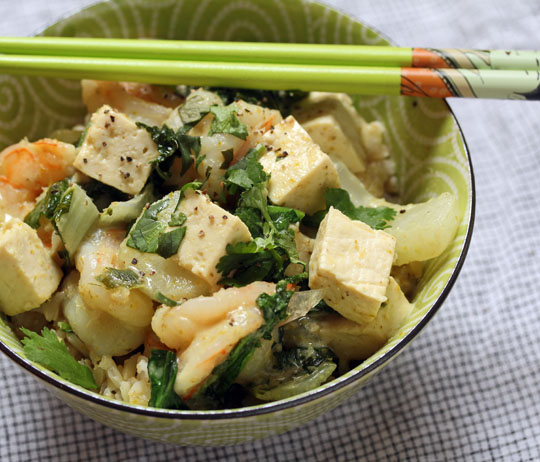 Keep a tub of Thai green curry paste in your fridge to make curries in a hurry, like this tofu, shrimp and greens version. #glutenfree [ThePerfectPantry]