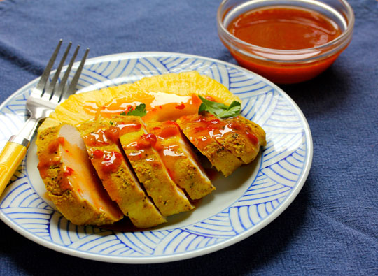 Grilled or baked, this coconut chicken with sweet chili sauce, will spice up your repertoire!