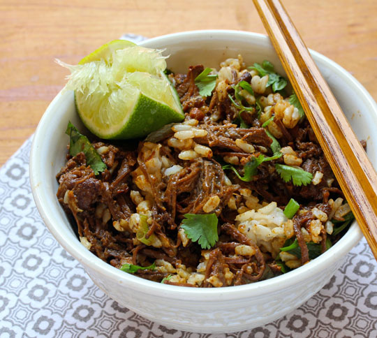 Be sure to stir plenty of lime and cilantro into this slow cooker shredded beef in peanut sauce!