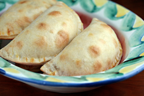 Store-bought discos, filled with chicken picadillo, make for quick and easy empanadas.