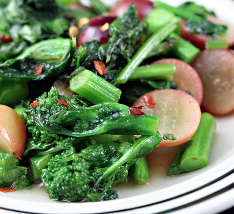 Broccoli raab with honey and grapes, an unusual combination that really works. The honey cuts the bitterness of the broccoli.