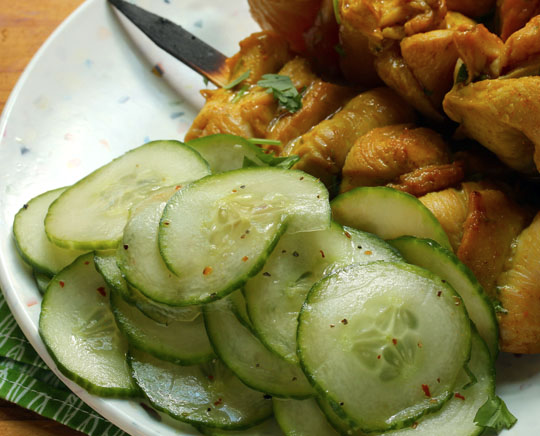 Light and easy sliced cucumber salad goes perfectly with Thai chicken satay skewers.