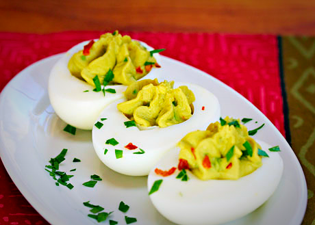 Sriracha avocado deviled eggs will be the hit of your next brunch party. #vegetarian