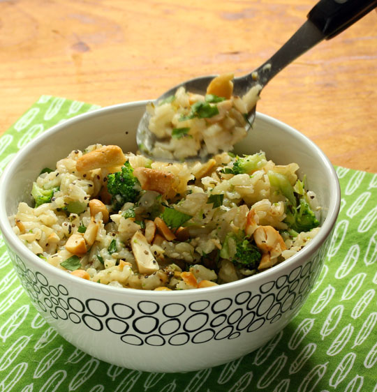 Cheesy broccoli brown rice is gooey enough to appeal to kids, and packed with vegetables. Add some chicken or shrimp to make a family-friendly main course. #vegetarian