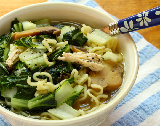 Chinese chicken noodle soup, packed with dark leafy greens and ramen noodles.